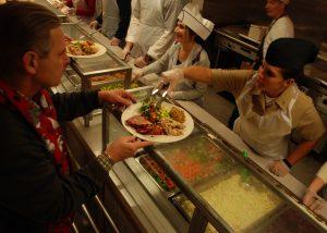 volunteer serving Christmas dinner
